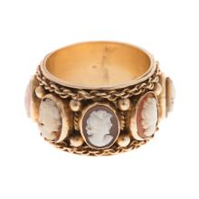 Lot 175: A Ladies Wide Carved Cameo Eternity Band in 14K