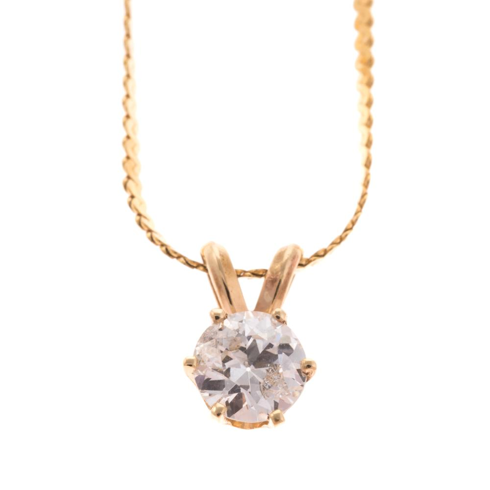 A Ladies Diamond Pendant in 14K Gold
