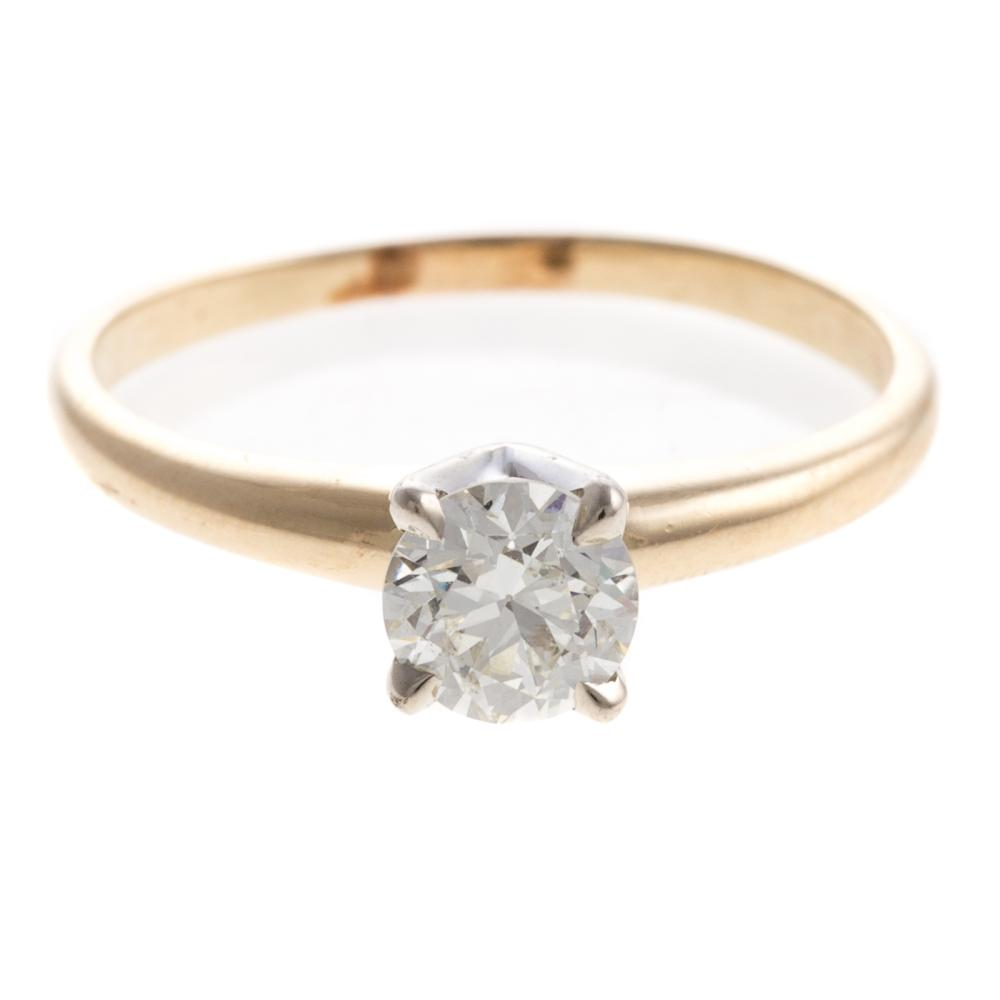 A Ladies Vintage Diamond Engagement Ring in 14K
