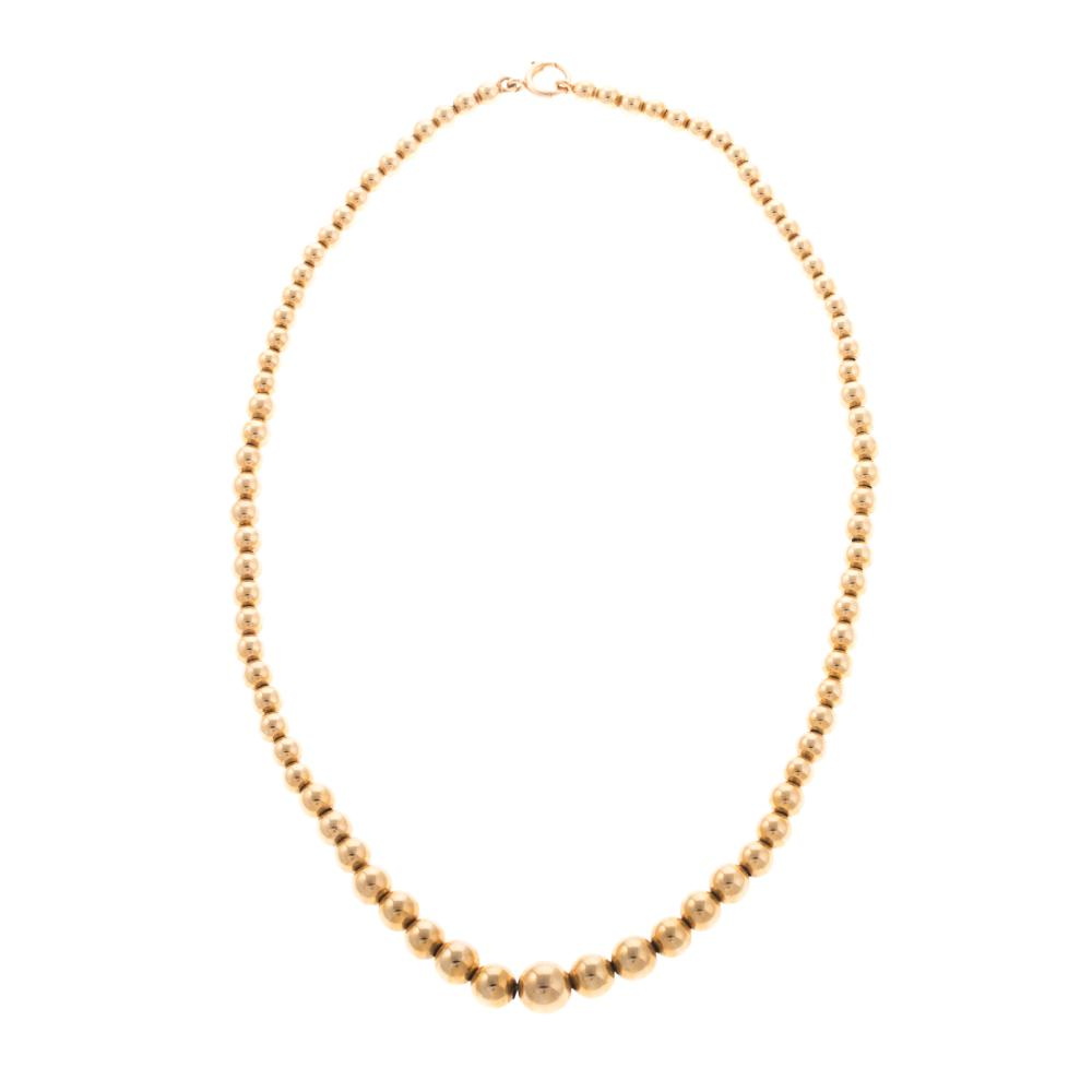 Lot 187: A Ladies 14K Yellow Gold Graduated Beaded Necklace