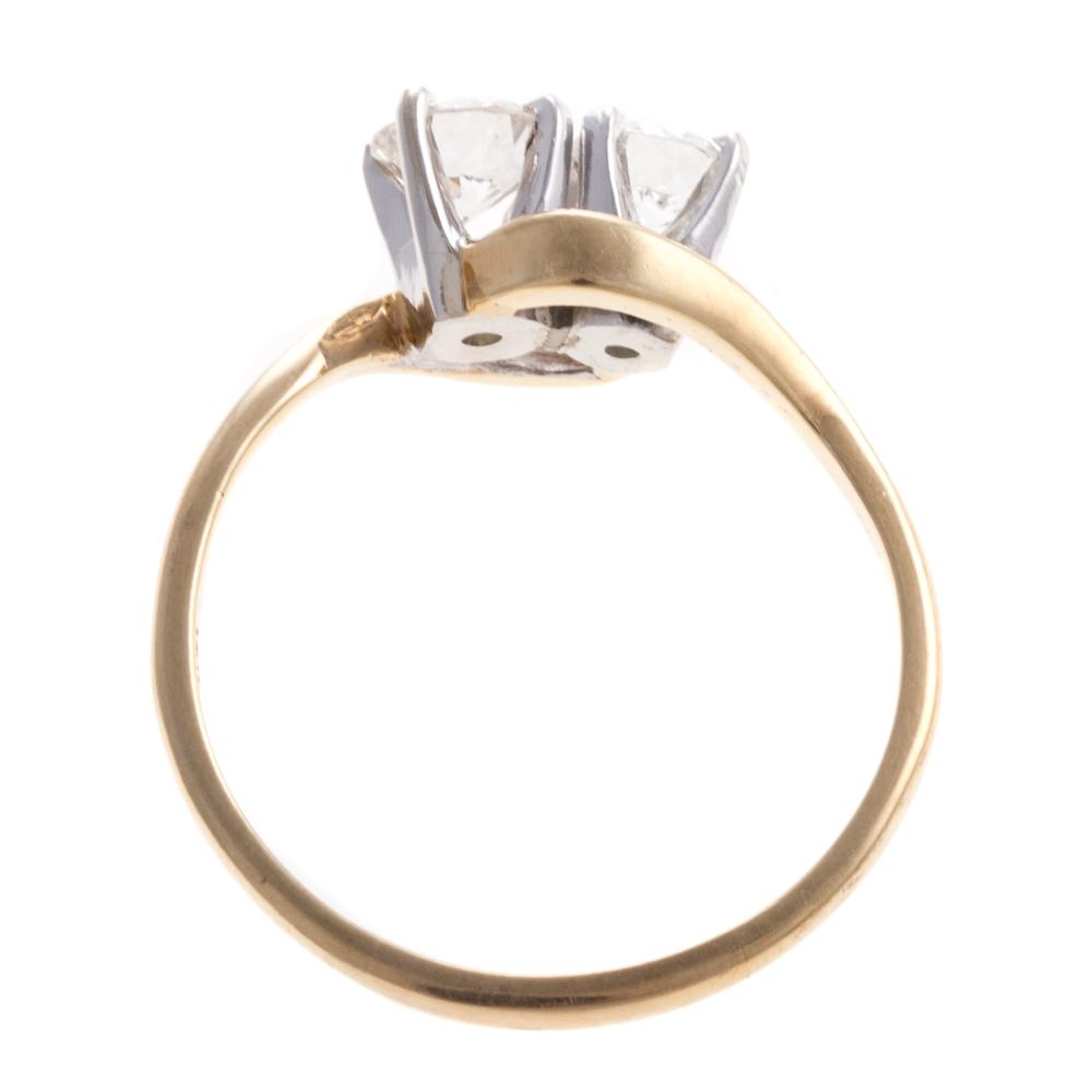Lot 194: A Ladies Vintage Diamond Bypass Ring in 14K