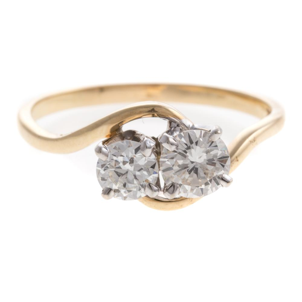 A Ladies Vintage Diamond Bypass Ring in 14K