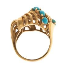 Lot 193: A Ladies Freeform Turquoise Ring in 18K