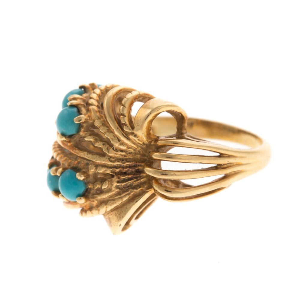 A Ladies Freeform Turquoise Ring in 18K