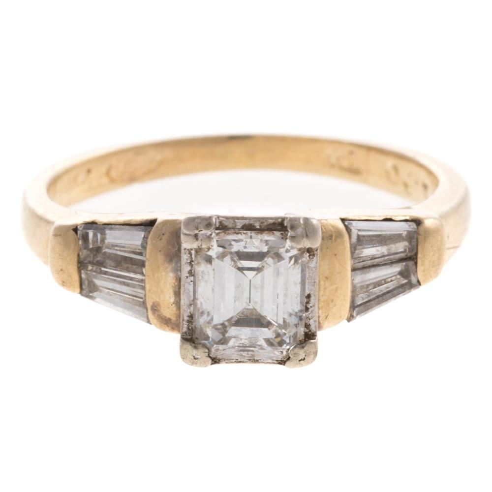 A Ladies Emerald Cut Diamond Engagement Ring