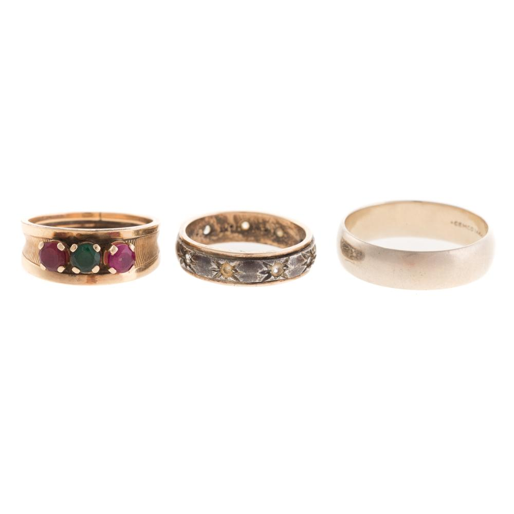 Lot 214: A Trio of Wide Gold Bands