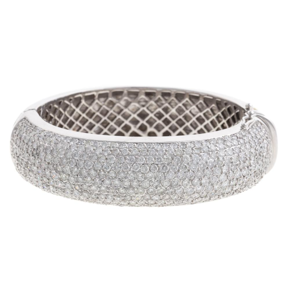 A Ladies Wide Diamond Bangle Bracelet in 14K