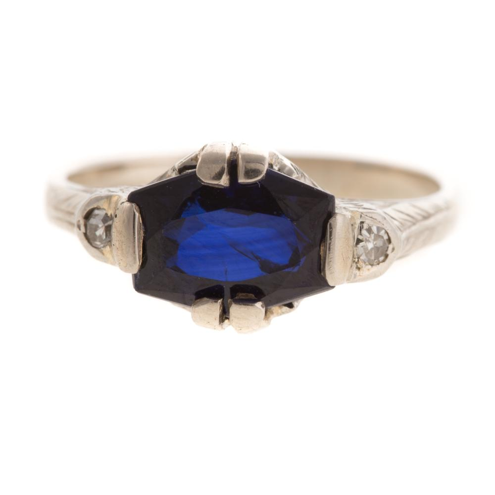 Lot 216: A Vintage Sapphire & Diamond Ring in Platinum