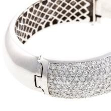 Lot 217: A Ladies Wide Diamond Bangle Bracelet in 14K