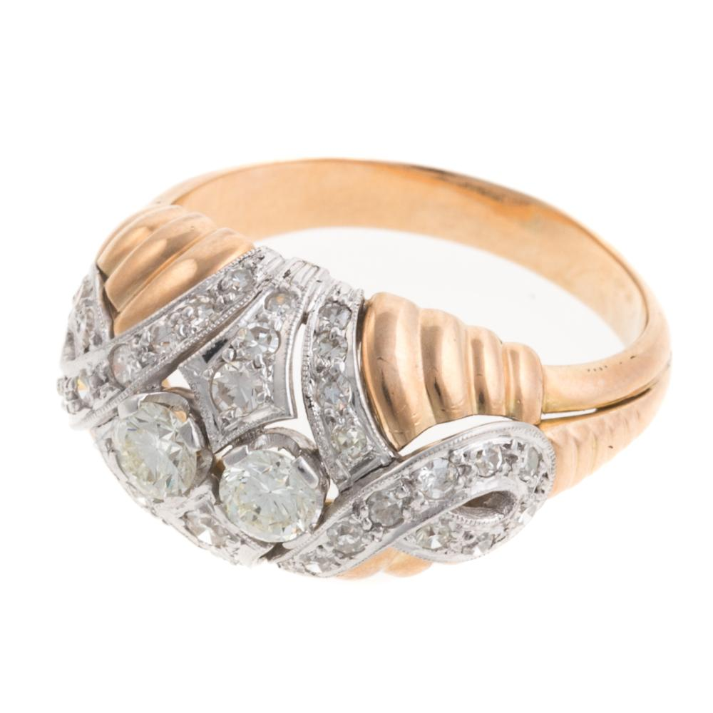 Lot 220: A Ladies Diamond Dome Ring in 18K Gold