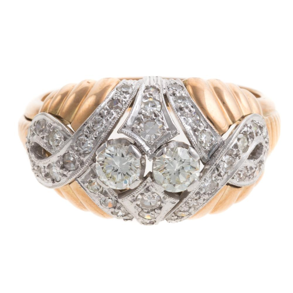 A Ladies Diamond Dome Ring in 18K Gold