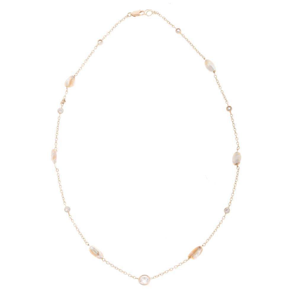 Lot 223: A 14K Diamond & Freshwater Pearl Station Necklace