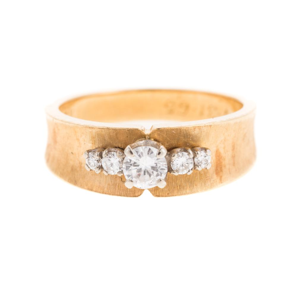 Lot 228: A Ladies Wide Diamond Band in 18K