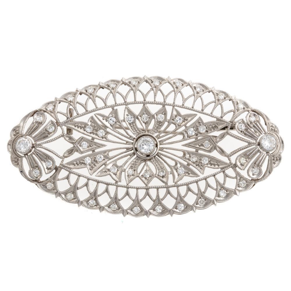 A Ladies Vintage Diamond Brooch in Platinum