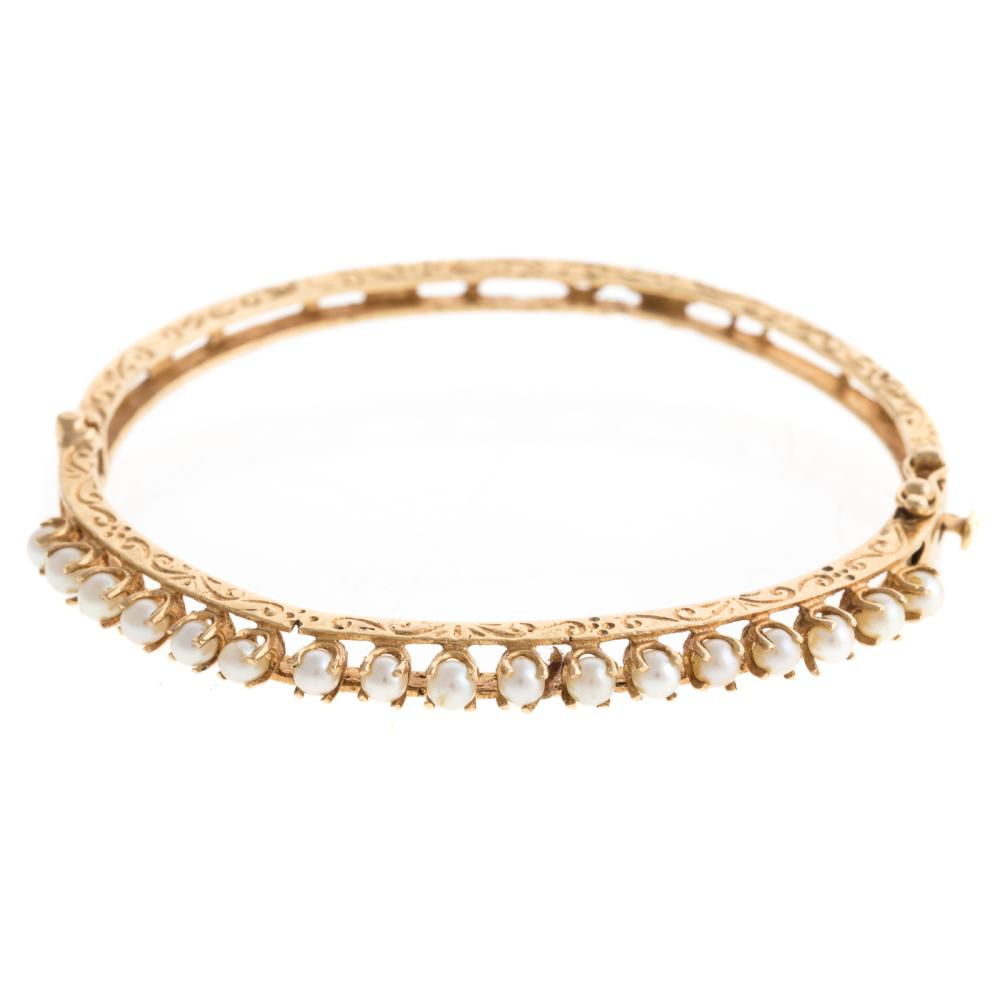 Lot 239: A Victorian Pearl Bangle & Rope Bracelet in 14K