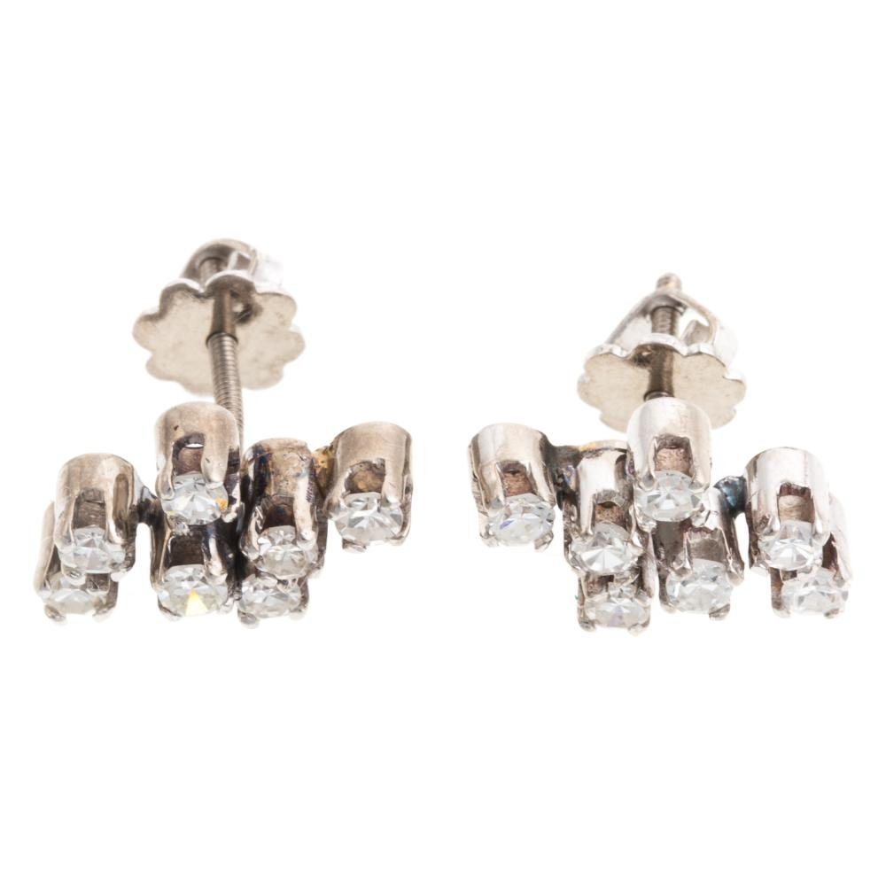 Lot 243: A Matching Vintage Diamond Ring & Earrings in 18K