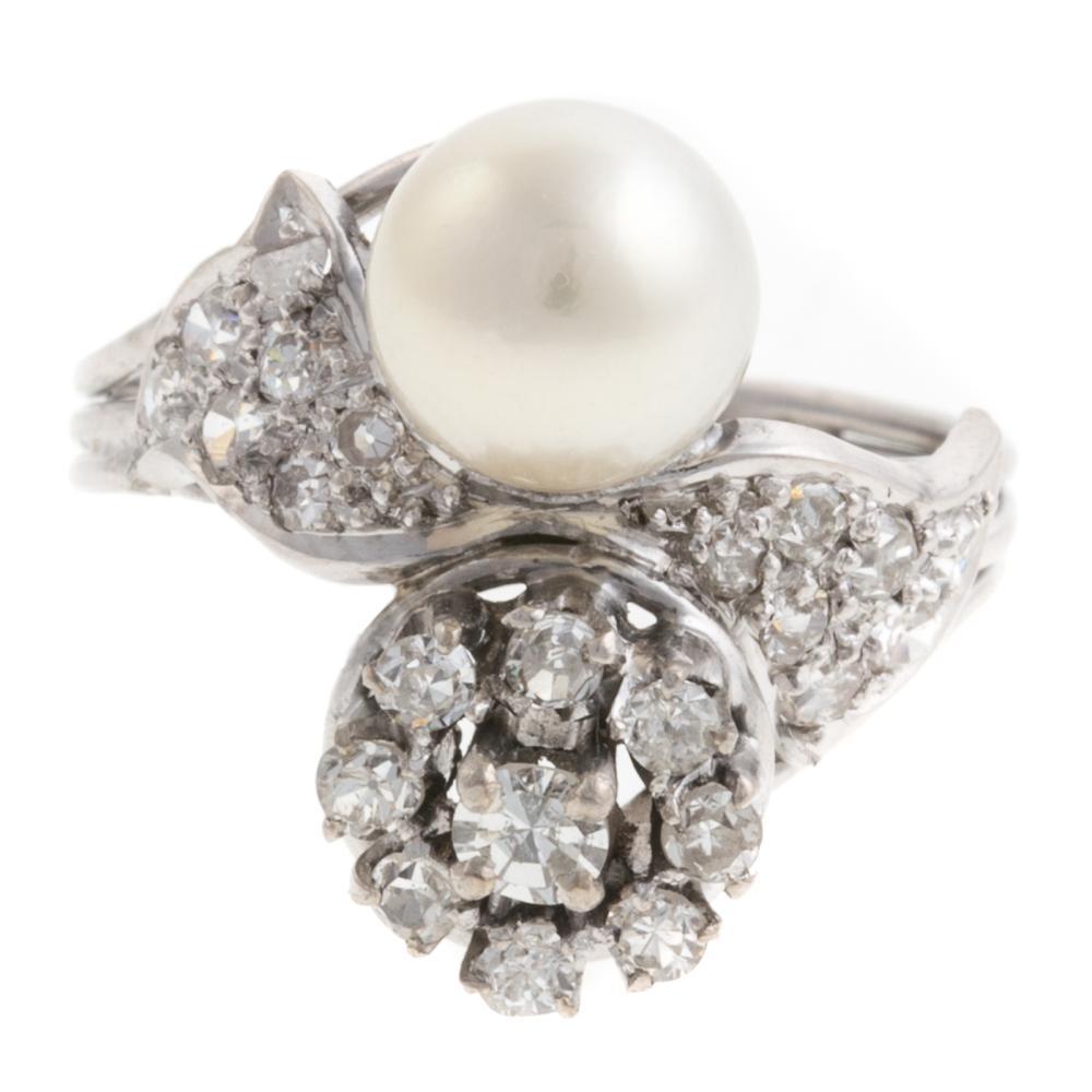 Lot 244: A Ladies Vintage Diamond & Pearl Ring in Platinum