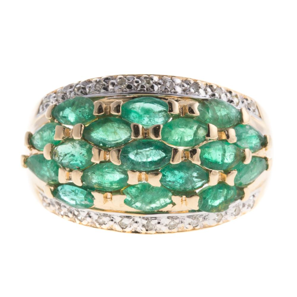 A Ladies Emerald and Diamond Wide Band in 14K