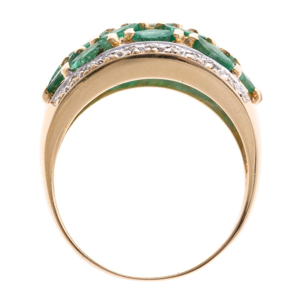Lot 249: A Ladies Emerald and Diamond Wide Band in 14K