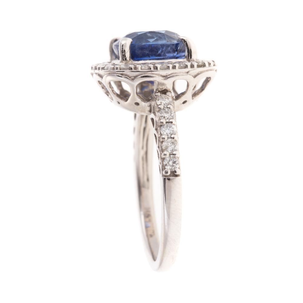 Lot 254: An Unheated Sapphire & Diamond Ring in 14K
