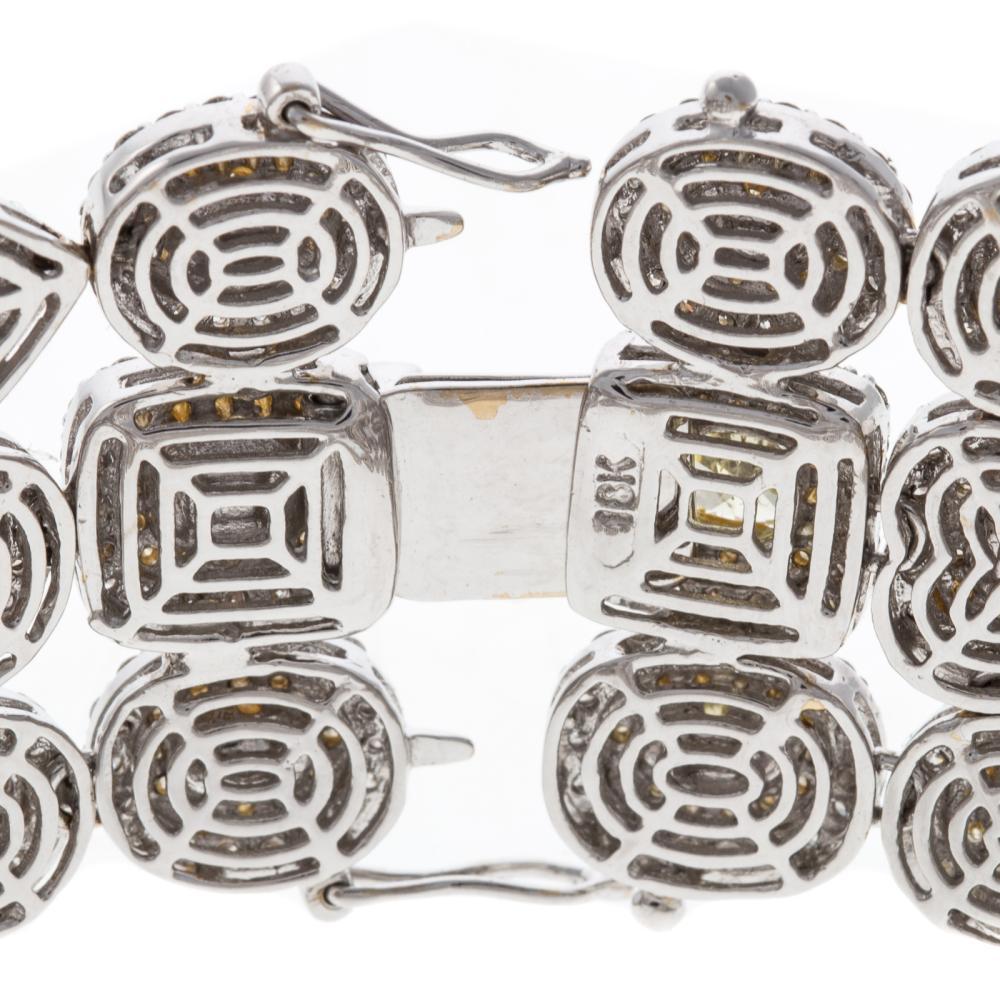 Lot 251: A 31.21ct Yellow & White Diamond Bracelet in 18K