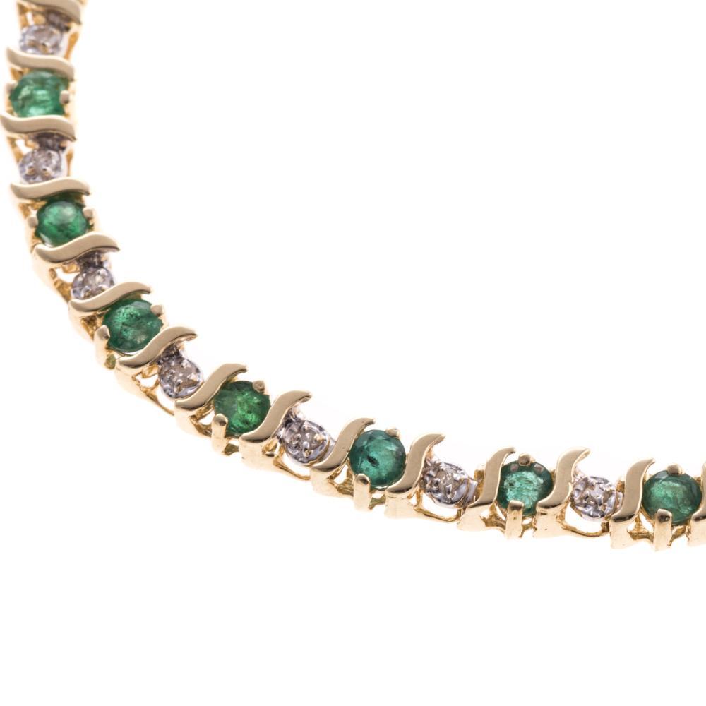 "Lot 250: A Emerald and Diamond ""S"" Link Bracelet in 14K"