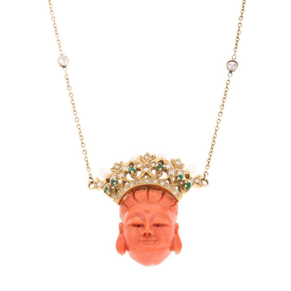 A Ladies Carved Coral Pendant with Diamonds in 14K