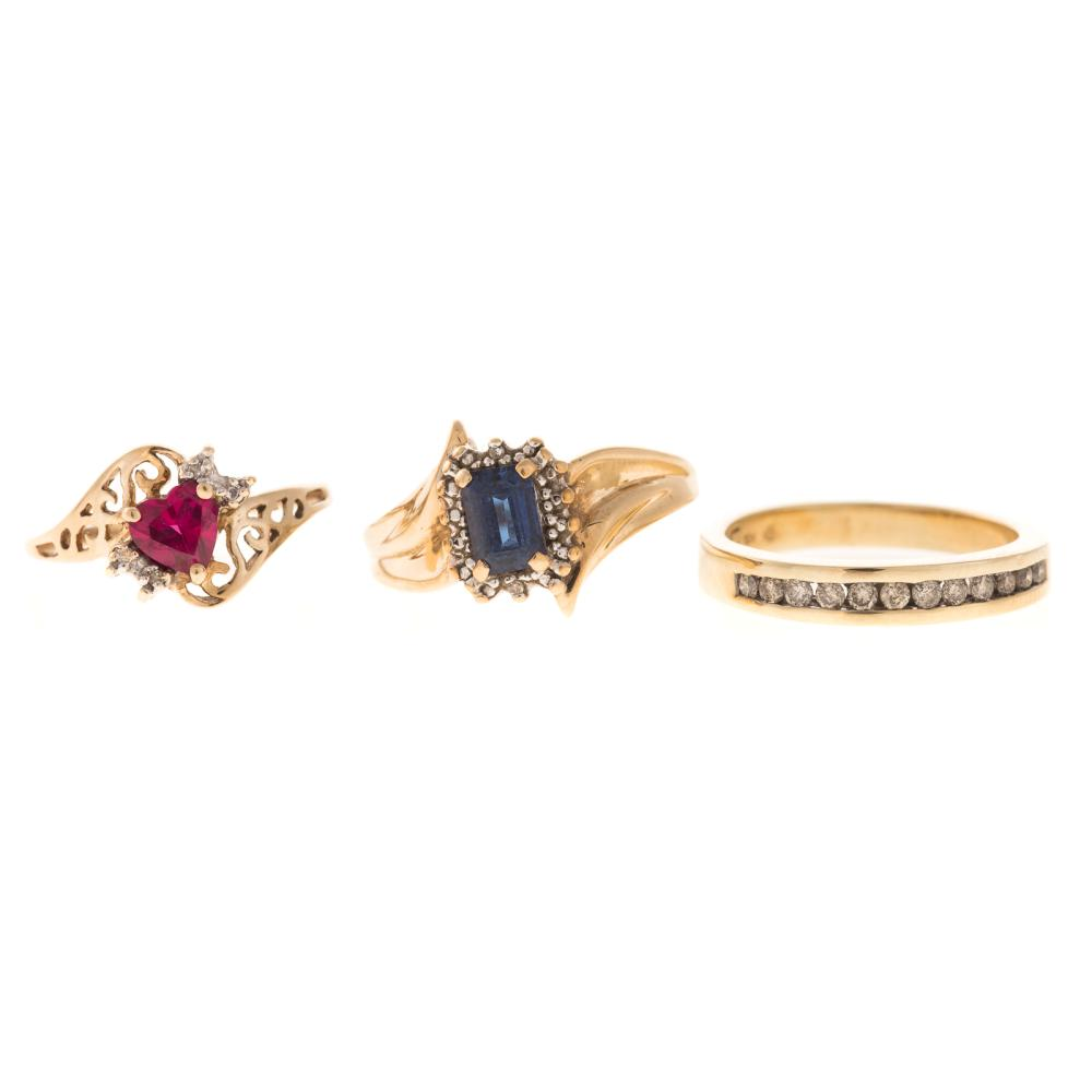 A Trio of Diamond & Gemstone Rings in Gold