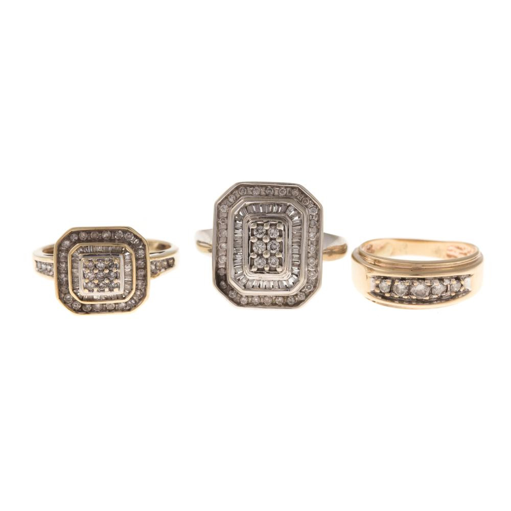 A Trio of Diamond Ring and Bands in Gold
