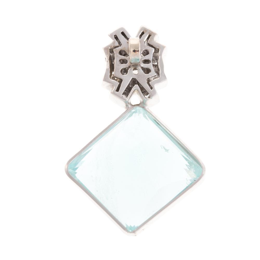 Lot 263: A Ladies Aquamarine & Diamond Pendant in 14K