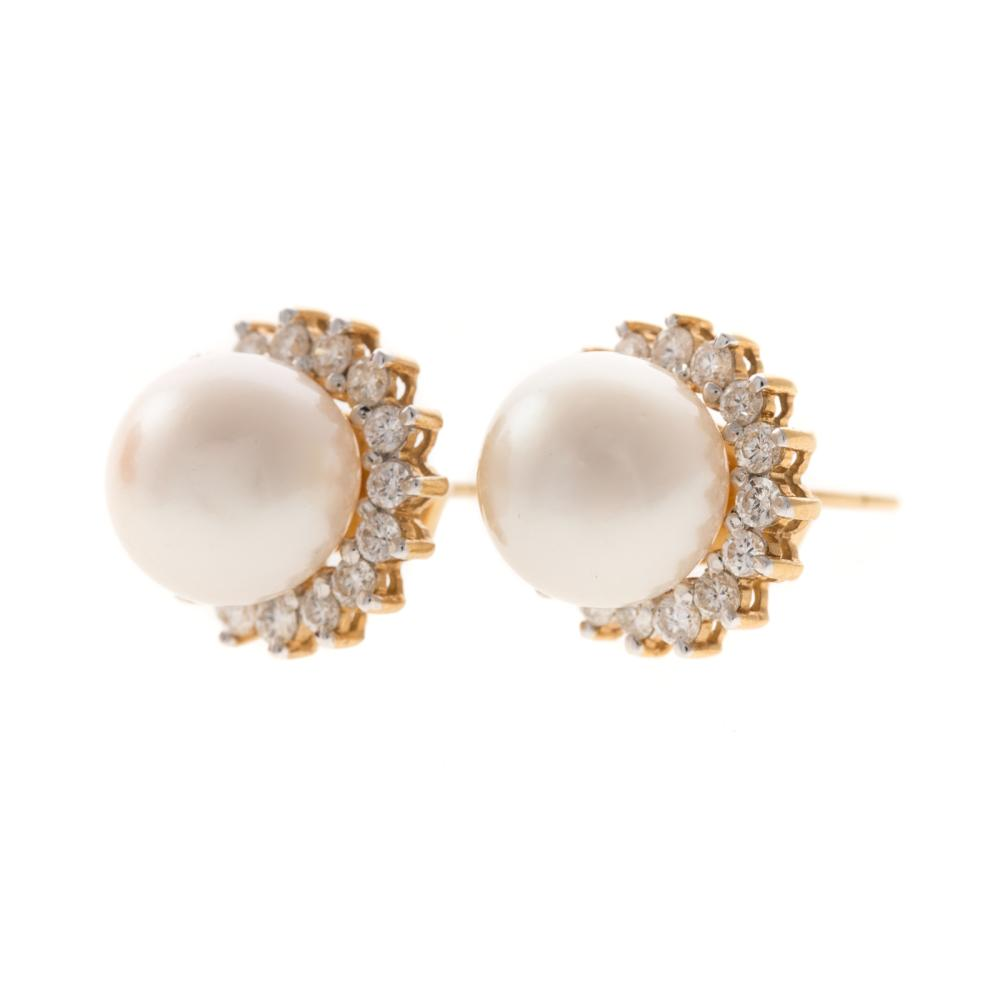 Lot 265: A Pair of Fine Pearl & Diamond Earrings in 18K