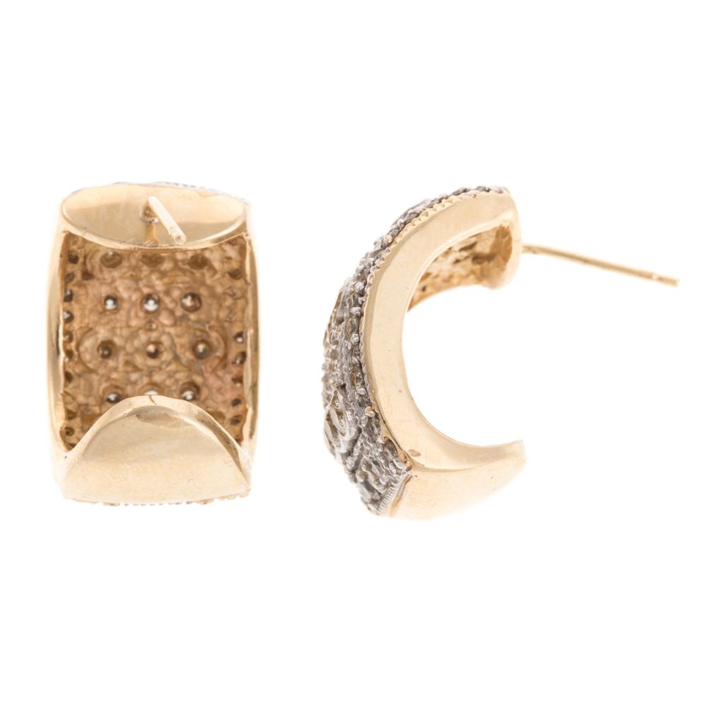 Lot 264: A Ladies Pair of Wide Diamond Earrings in 14K