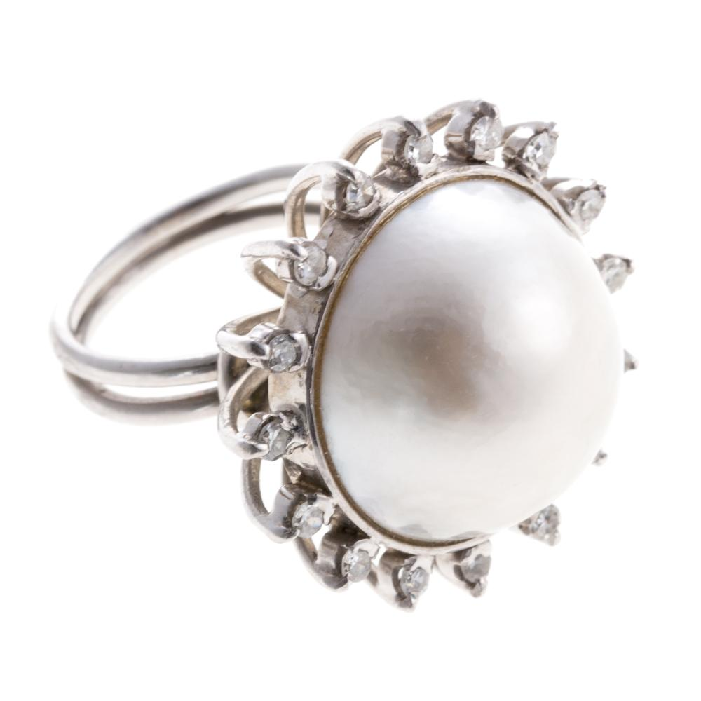 Lot 266: A Ladies Mabe and Diamond Pearl Ring in 14K
