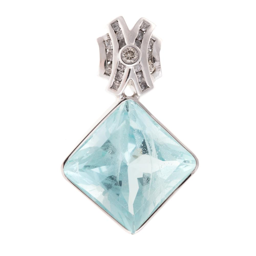 A Ladies Aquamarine & Diamond Pendant in 14K