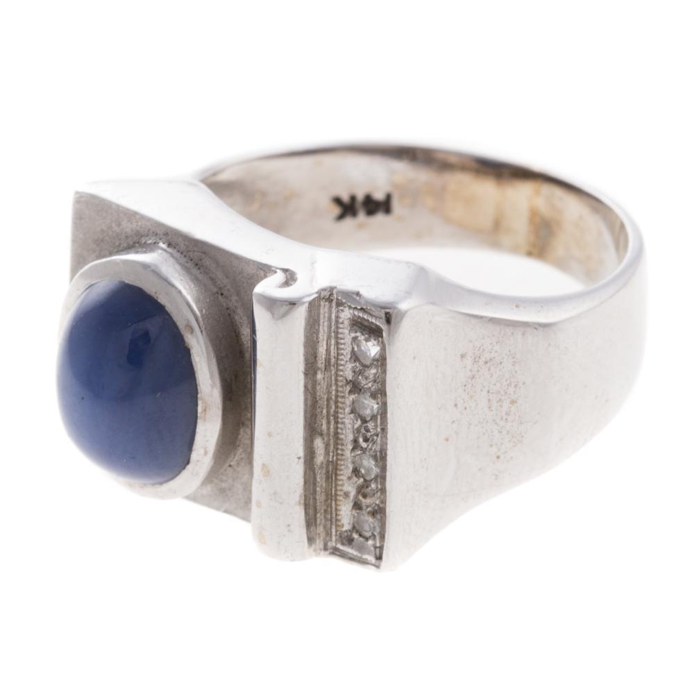 Lot 268: A Gentleman's Star Sapphire & Diamond Ring in 14K
