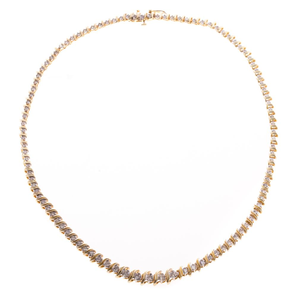 A Ladies Diamond Tennis Necklace in 18K