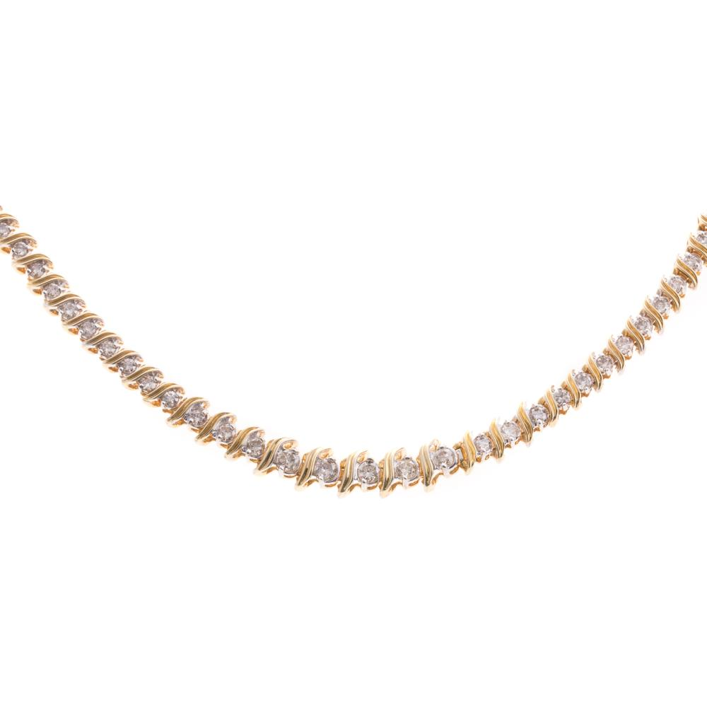 Lot 272: A Ladies Diamond Tennis Necklace in 18K