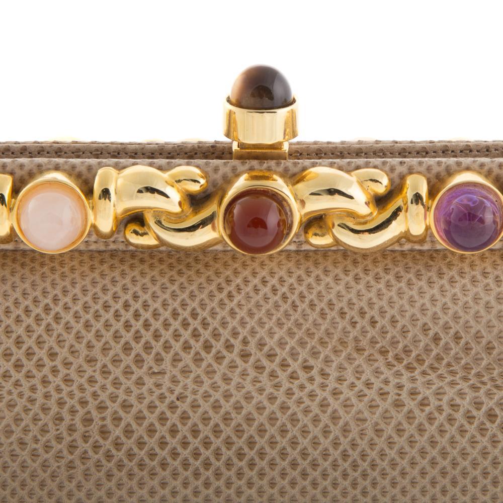 Lot 309: A Judith Leiber Snakeskin Embellished Clutch