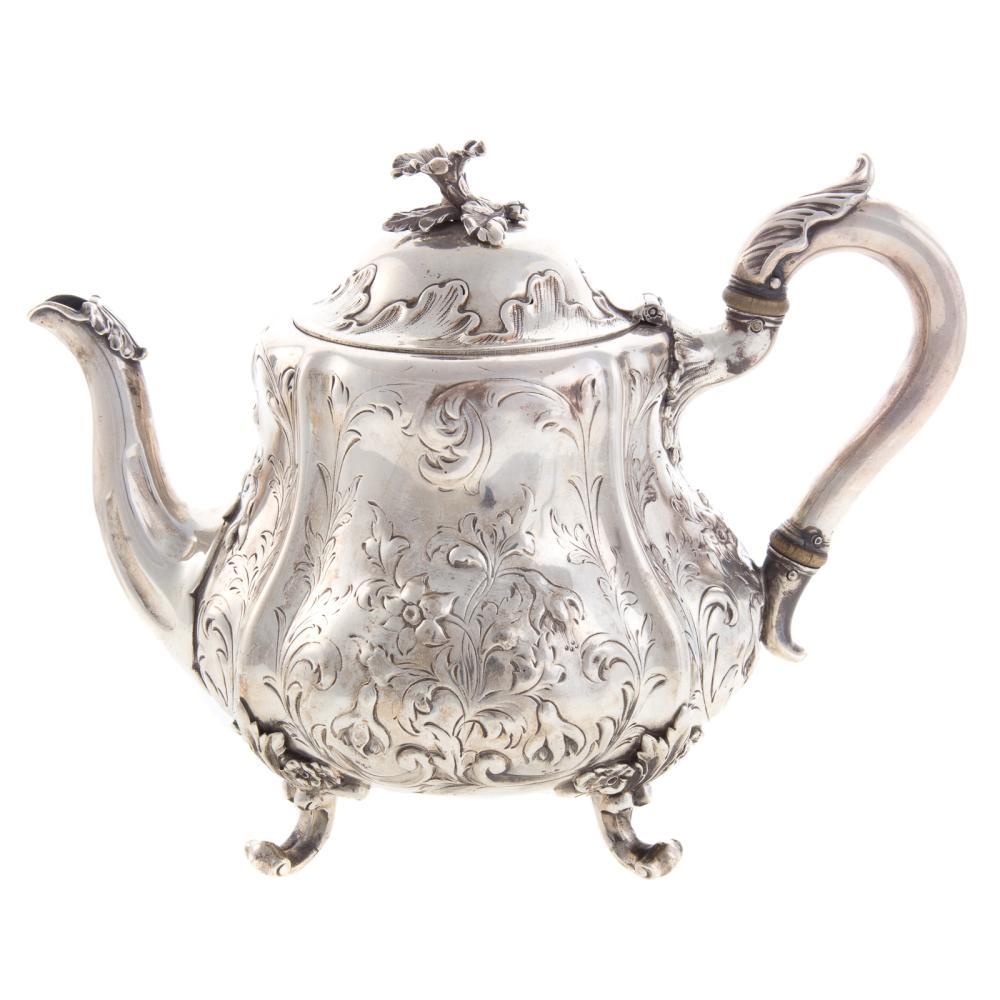 Lot 460: Victorian Silver Foliate Repousse Teapot