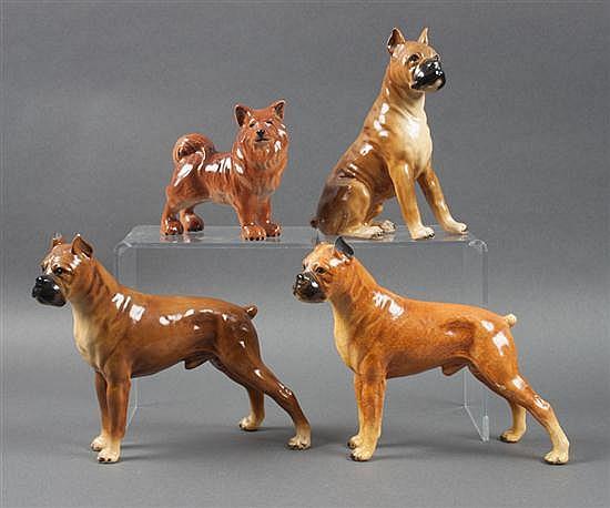 Three Mortens Studio ceramic and lead boxer dog figures, and a ceramic akita figure