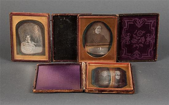 [Photography] Three half-plate daguerreotype portraits in stamped leather cases, mid 19th century