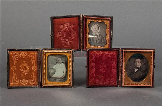 [Photography] Three 1/8 plate daguerreotypes in stamped leather cases, mid 19th century