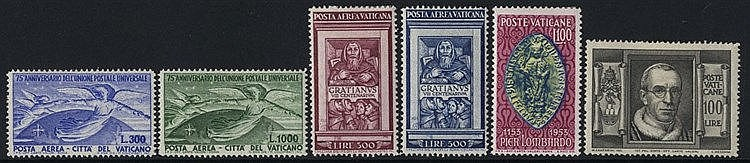 1929-65 M & VFU collection housed in two black page Nubian albums