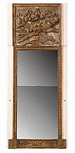 Trumeau de forme rectangulaire en bois relaqué blanc et bois doré à frise de rubans ; la partie supérieure à décor de carquois et de flambeau dans des rinceaux feuillagés.