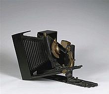 ARMAN (1928-2005)  HOMMAGE A NADAR, 1986  Bronze à patine noire et dorée  S
