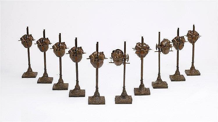 CESAR (1921-1998) CŒUR ECLATE, 1986 Ensemble de dix bronzes à patine b