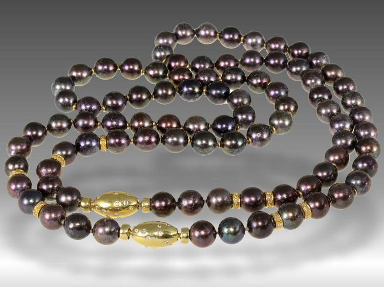 Very long pearl necklace with two diamond clasps