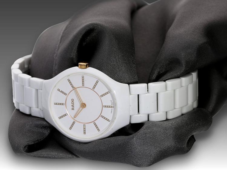 Modern wristwatch by Rado, new