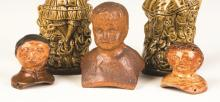Decorated Redware Doll Heads and Sewer Tile Head