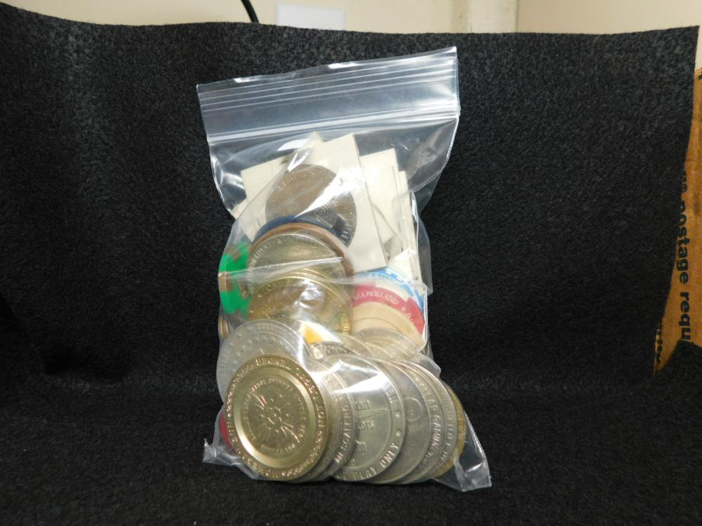 LARGE BAG OF CASINO TOKENS AND OTHER ITEMS